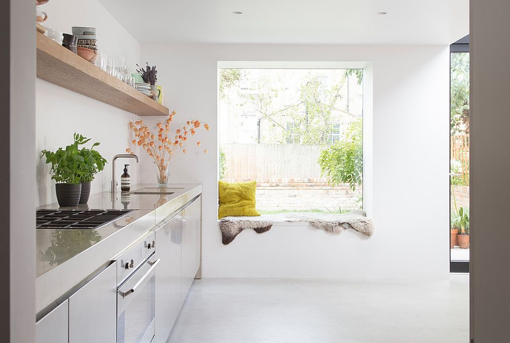 Window seat in the white Scandinavian kitchen that you would hardly notice from a distance