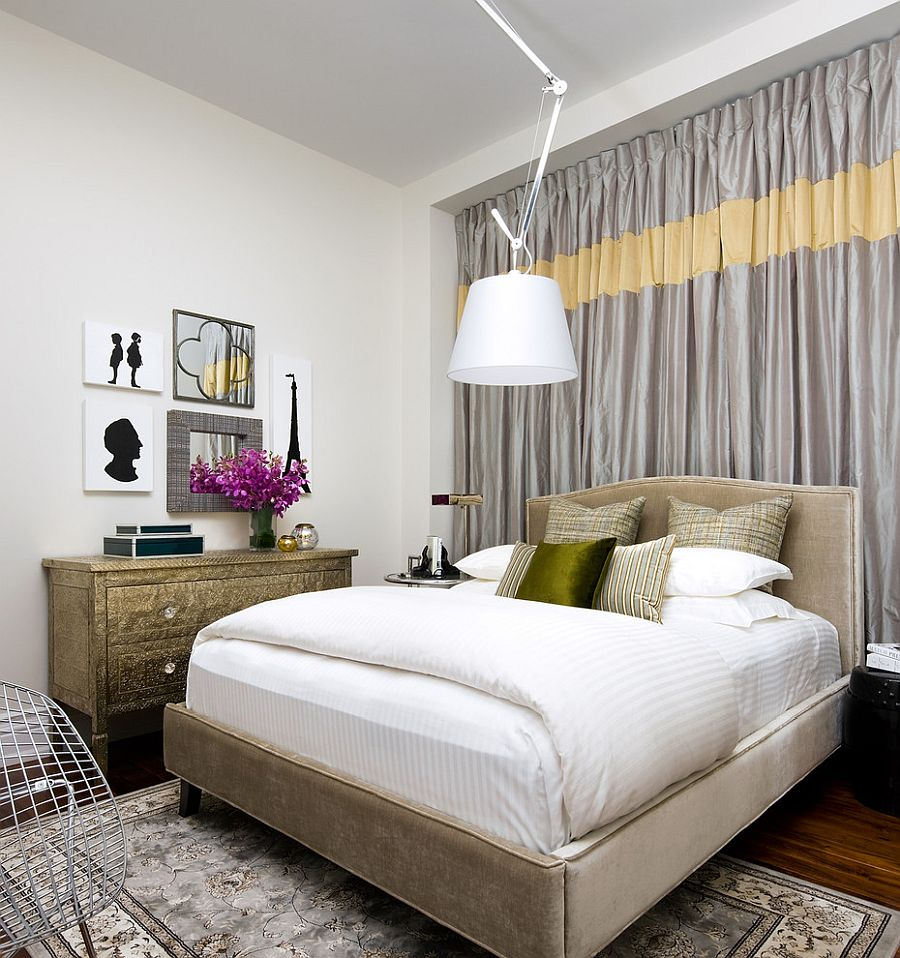 Yellow band on gray drapes brings brightness to the entire bedroom