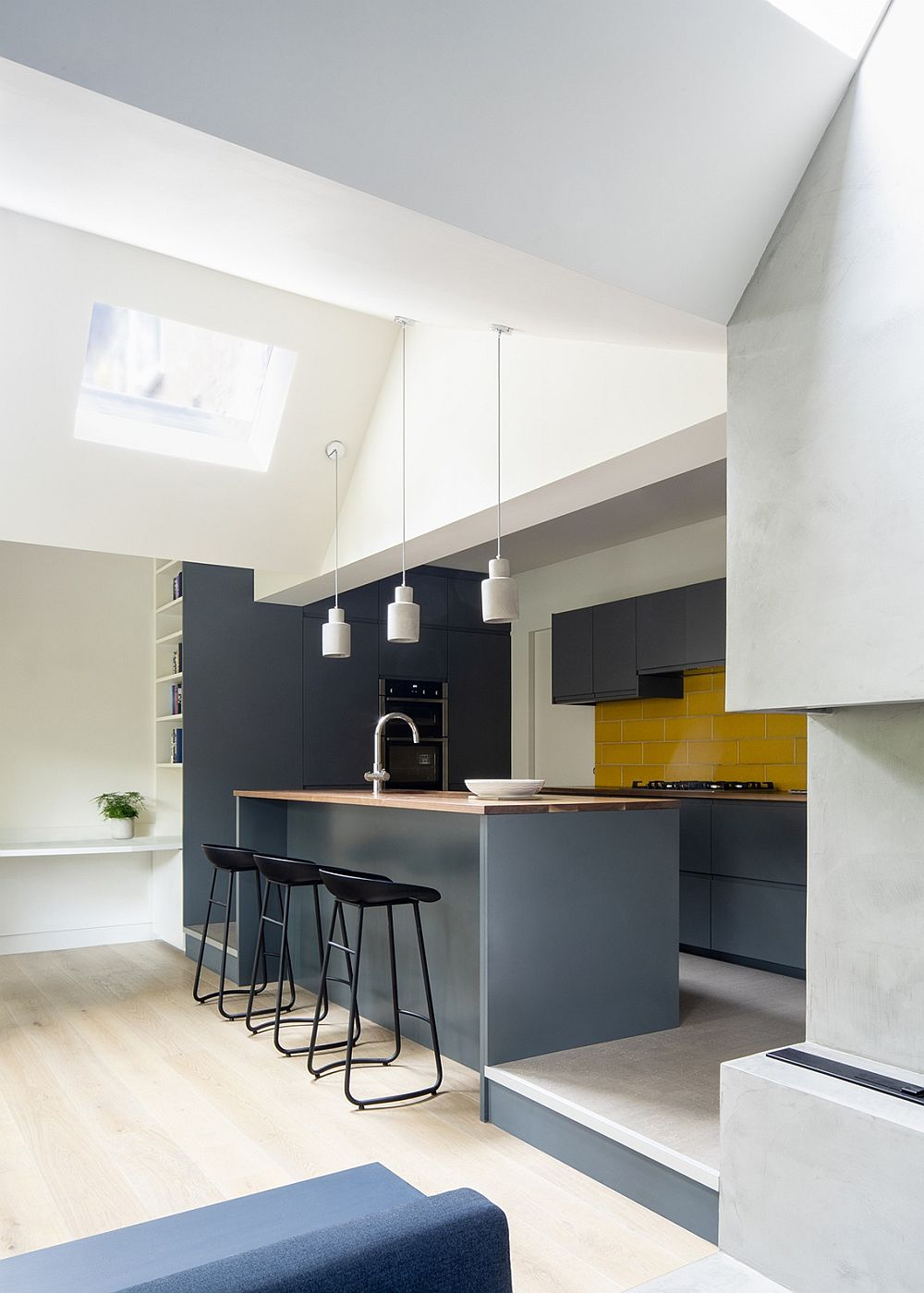 Yellow coupled with bluish-gray in the kitchen