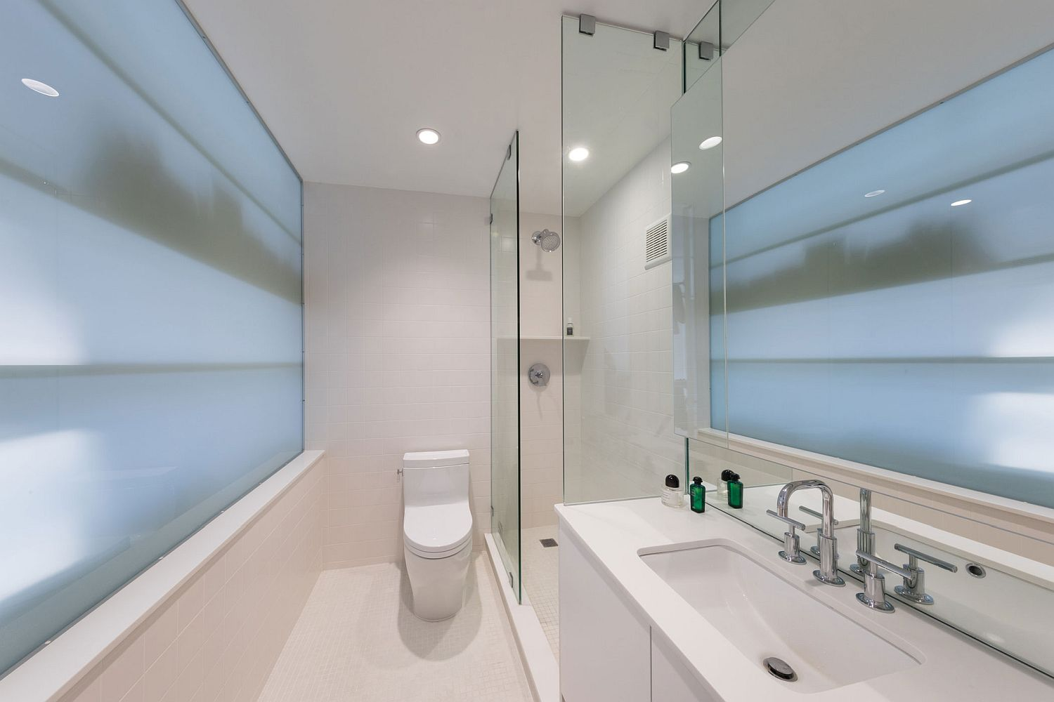 All-white tiny bathroom of the West 56th Penthouse in NYC