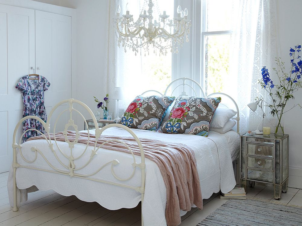 Bedding and accents bring an air of femininity to this white shabby chic bedroom