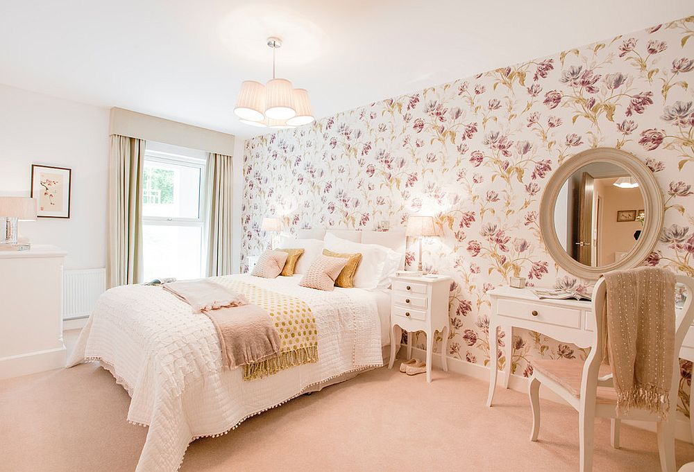 Bedroom accent wall clad in floral wallpaper