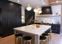 Black-and-gold-bar-stools-along-with-kitchen-cabinets-and-a-central-island-in-white-217x155