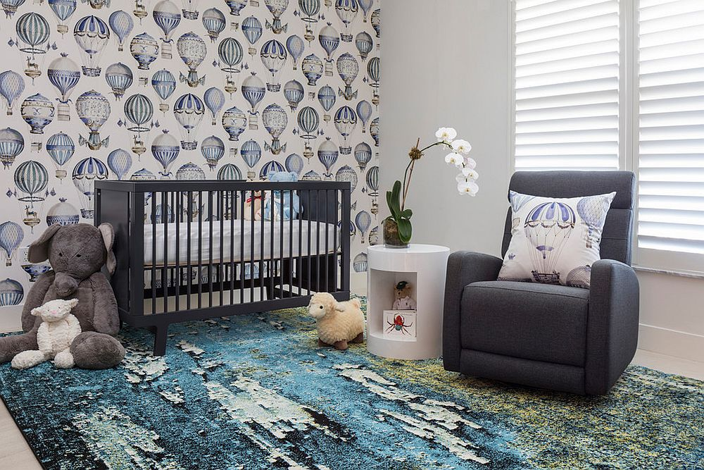 Blue nursery with a hot air balloon wallpaper that is a trendy choice