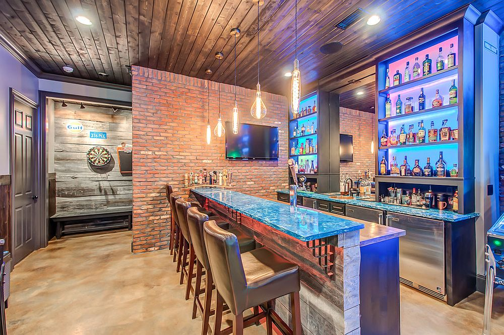 Budget basement bar and gameroom idea with brick walls and vintage appeal