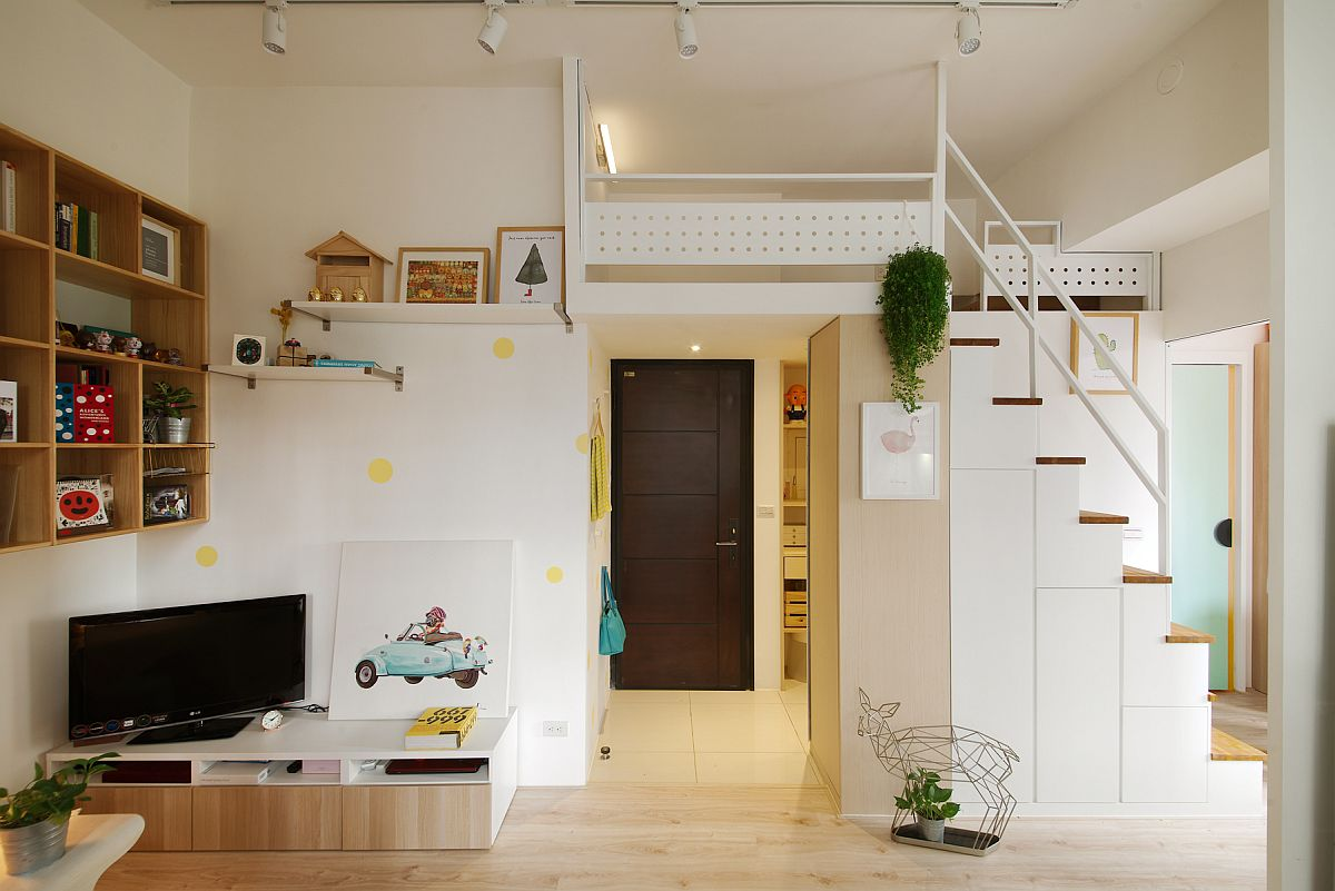 Call it a loft level or mezzanine space, the small apartment benefits from utilization of vertical space