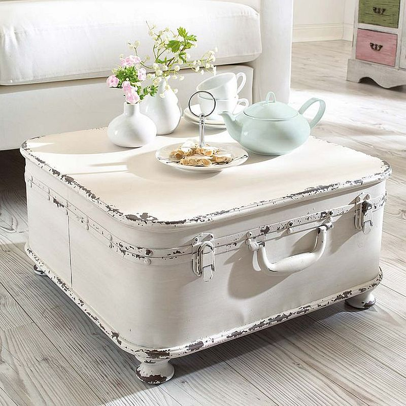 Covering an old suitcase in white makes it perfect for the shabby chic living room