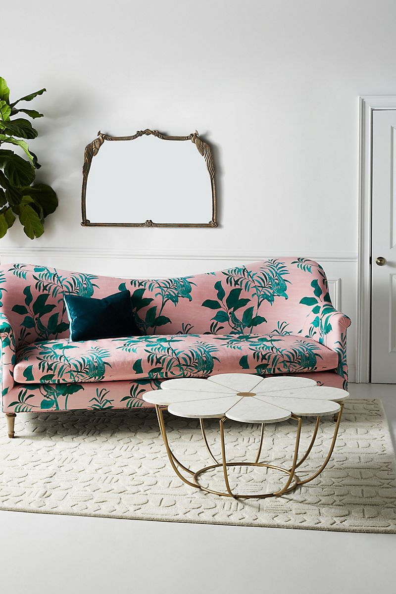 Curved sofa with pink and green fabric