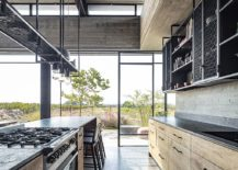 Dining-area-and-kitchen-of-the-Tel-Aviv-home-connected-with-the-fields-outside-217x155
