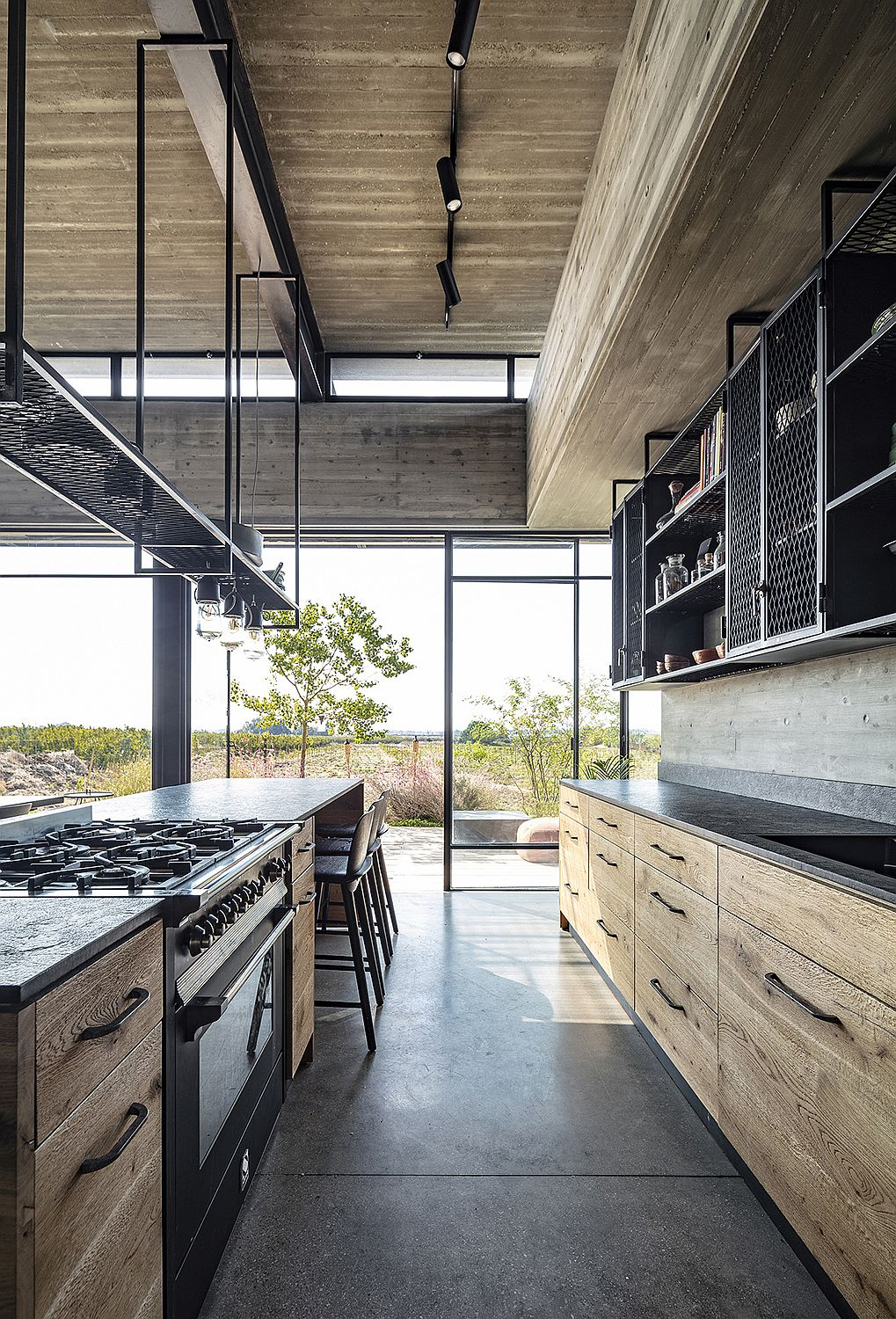 Dining area and kitchen of the Tel Aviv home connected with the fields outside