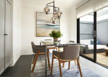 Dining-area-connected-to-the-backyard-in-white-and-gray-217x155