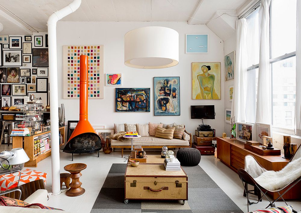 Eclectic living room with suitcases in the corner and a cool coffee table in the center