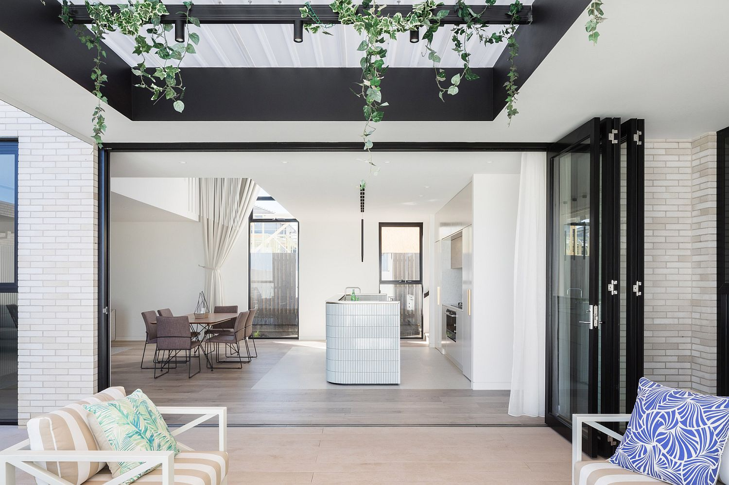 Folding glass doors are the perfect way to connect the kitchen with the deck outside