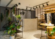 Gorgeous-lighting-and-metallic-mesh-shape-the-living-area-of-the-store-217x155