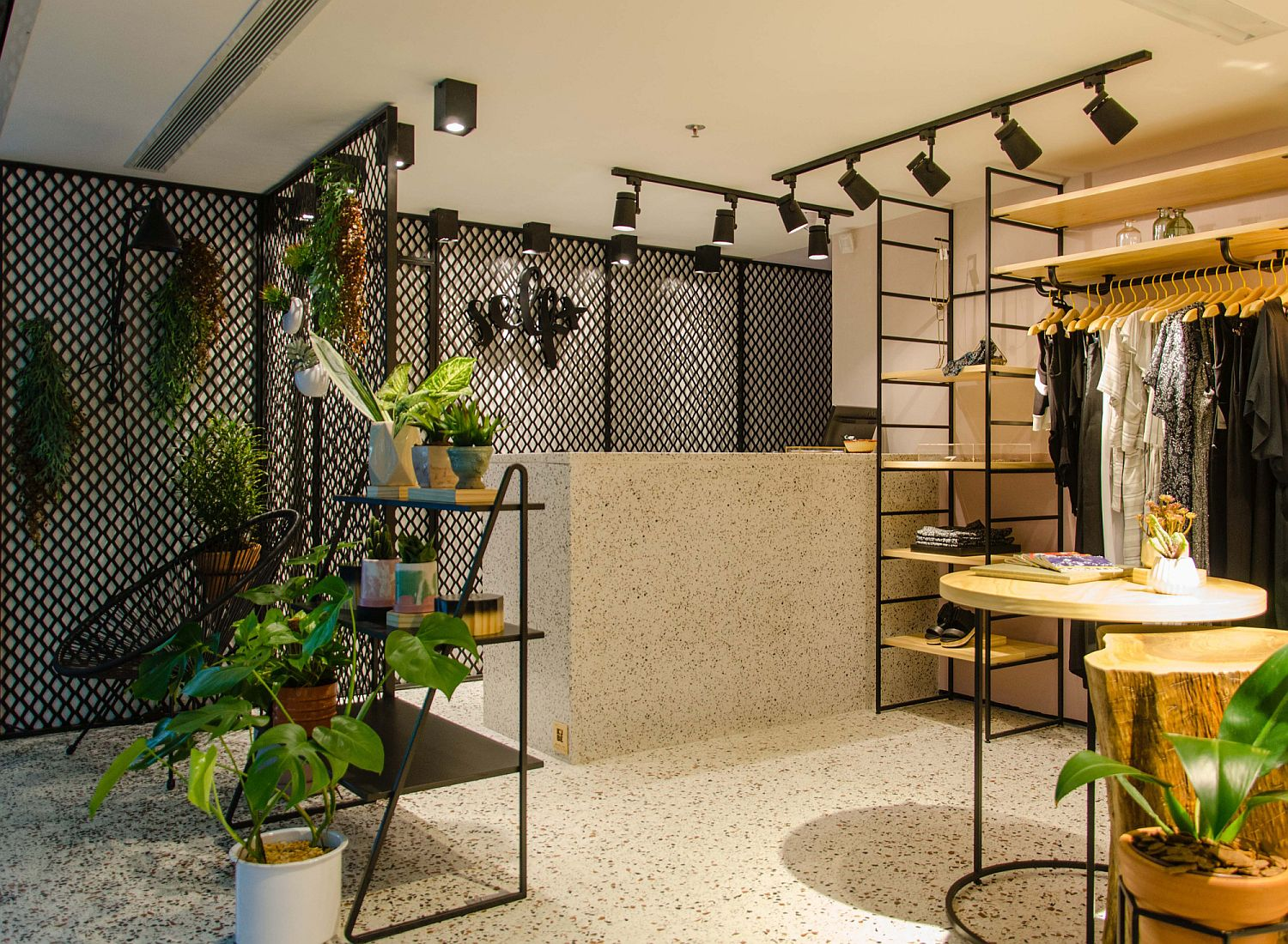 Gorgeous-lighting-and-metallic-mesh-shape-the-living-area-of-the-store