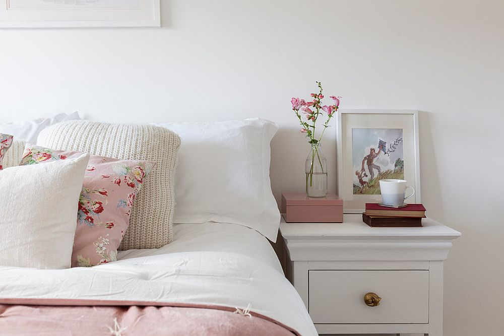 Gray and white bedroom with pops of pastel pink