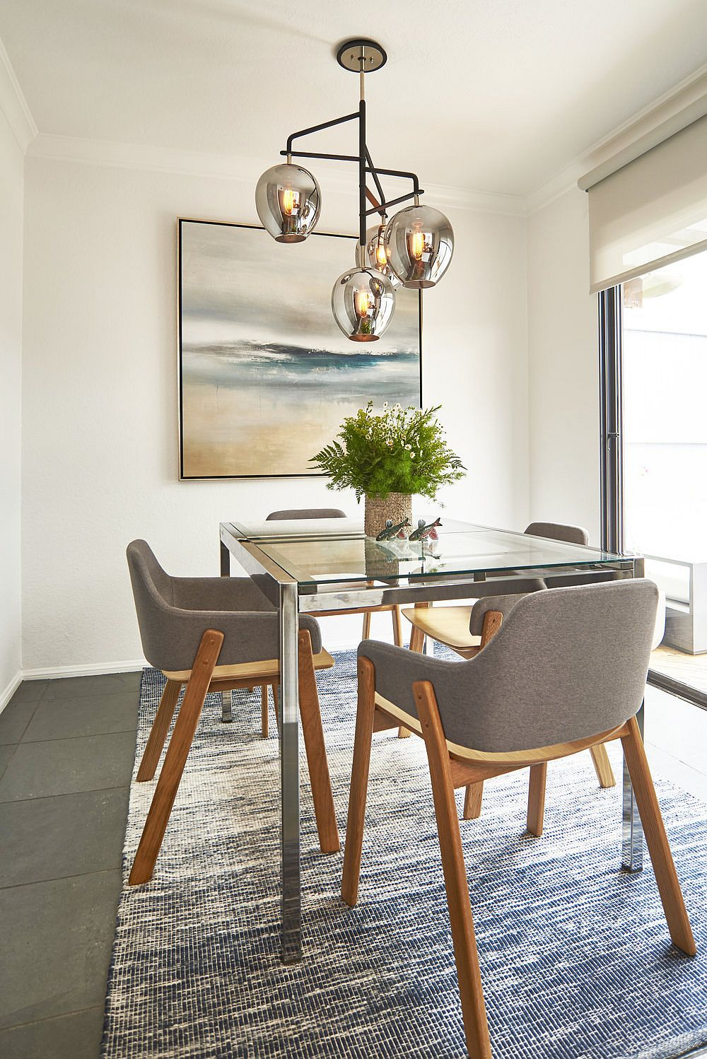 Gray chairs and metallic lighting fixture for the modern dining room
