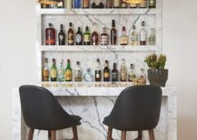 Home-bar-with-marble-backsplash-and-counter-along-with-a-couple-of-bar-stools-217x155