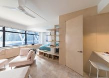 In-built-storage-features-and-wooden-decor-give-the-apartment-a-space-savvy-style-217x155