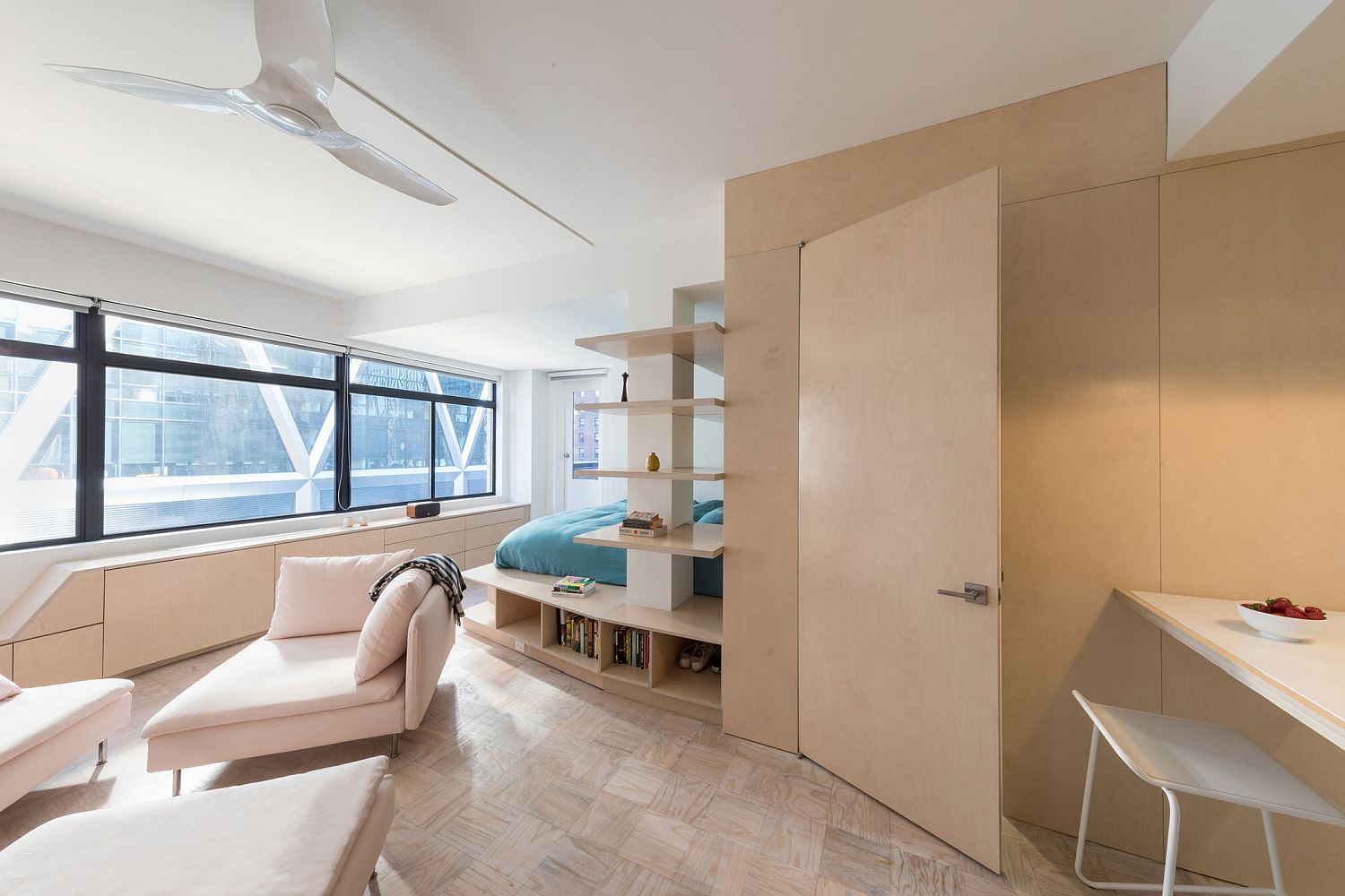 In-built storage features and wooden decor give the apartment a space-savvy style
