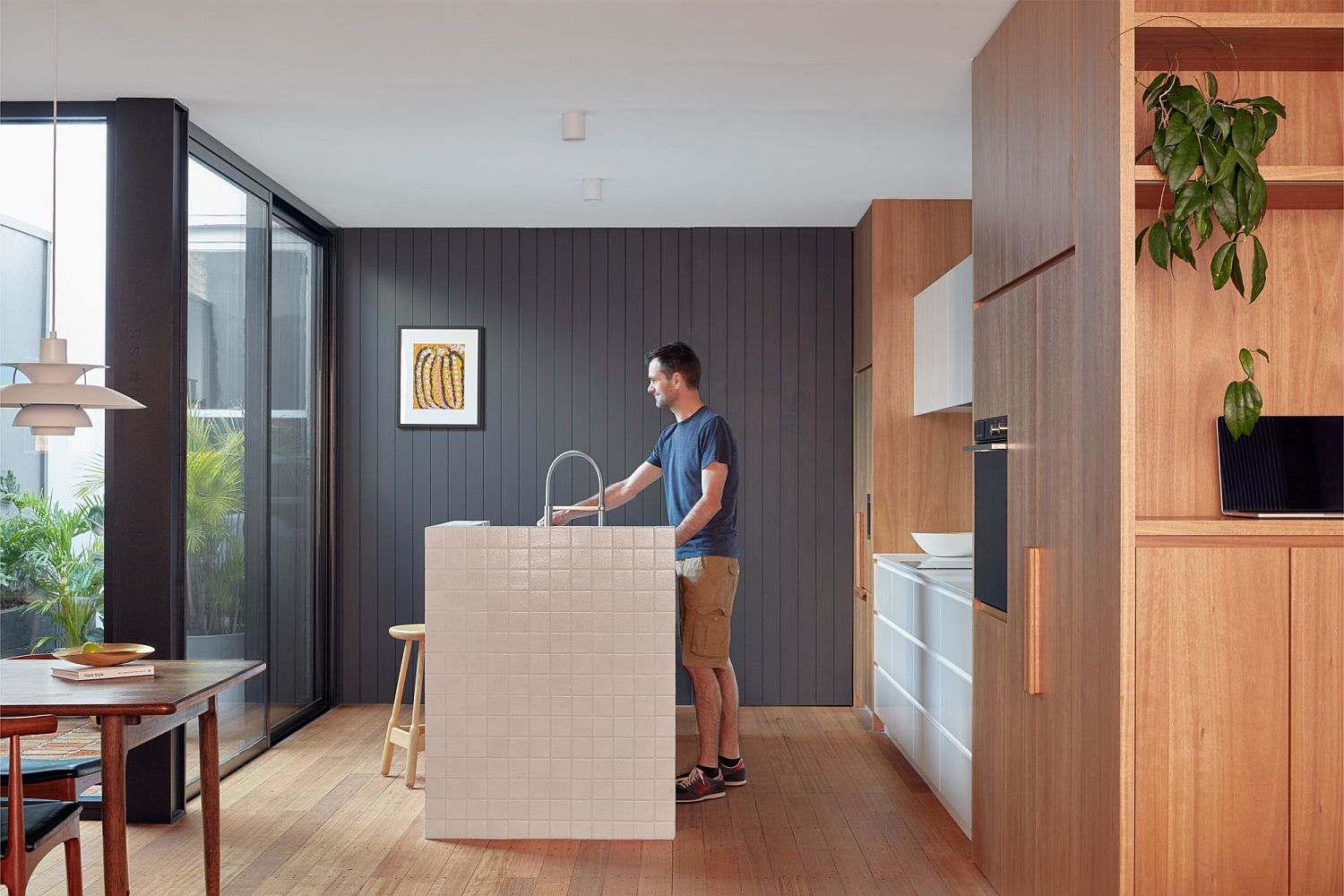 Kitchen of Brick & Gable House in Melbourne with an atrium