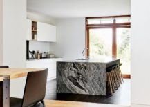 Landscape-outside-brings-ample-natural-light-into-the-kitchen-with-stunning-stone-island-217x155