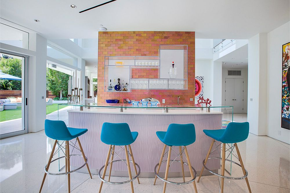 Light-blue-bar-stools-in-kitchen-with-ample-natural-lighting