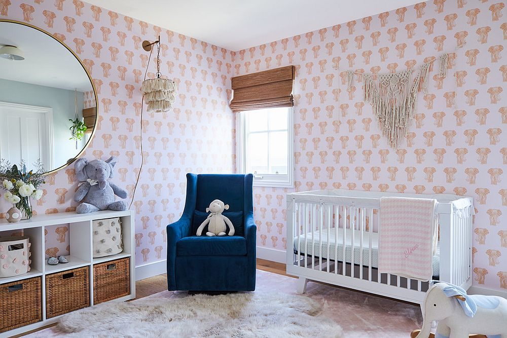 Light-filled beach style nursery with a wallpapered backdrop that features elephant motifs