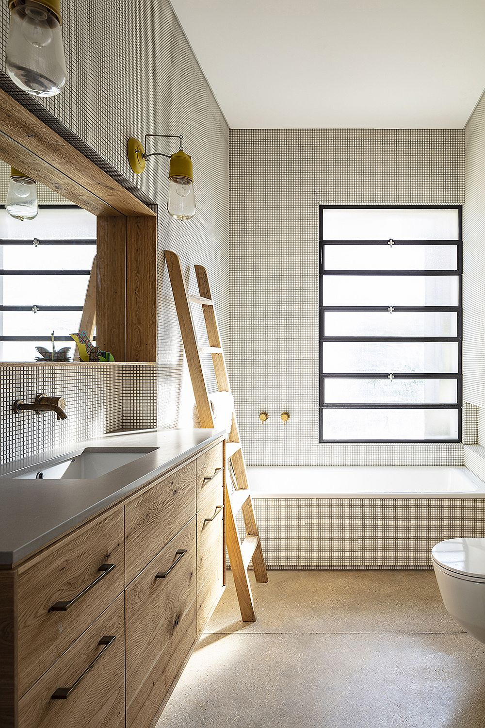 Light-filled modern bathroom in white and wood