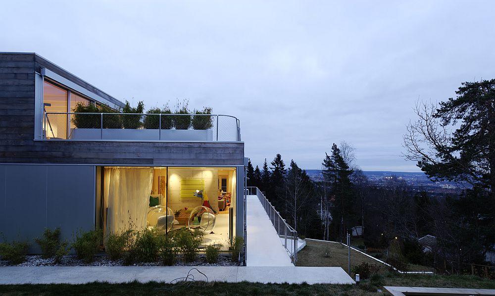 Light wood and concrete exterior of the contemporary home