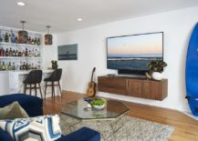 Living-room-of-the-beach-style-bachelor-pad-with-a-bar-in-the-corner-217x155
