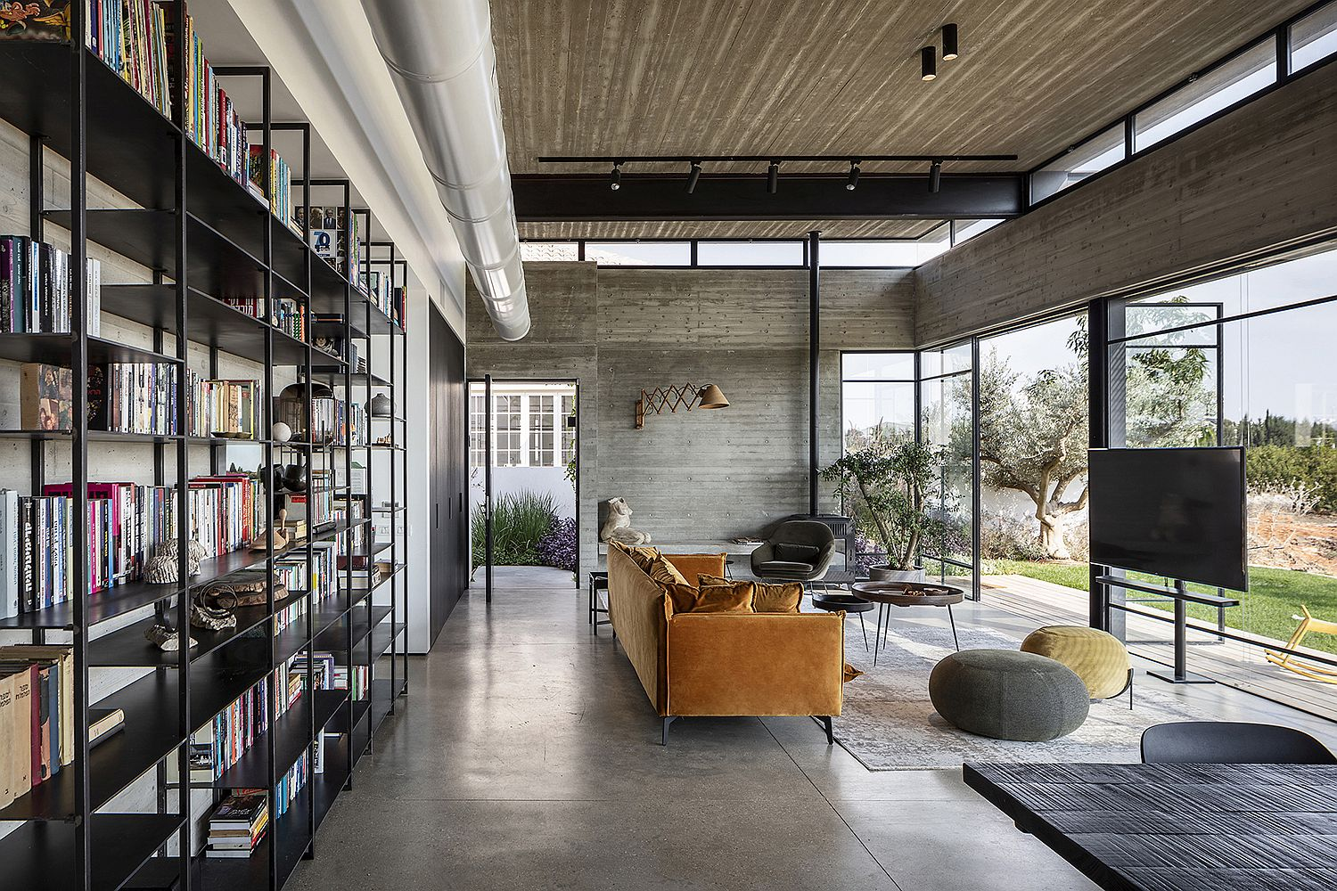 Metal pipes and minimal bookshelf acts unique appeal to the living space