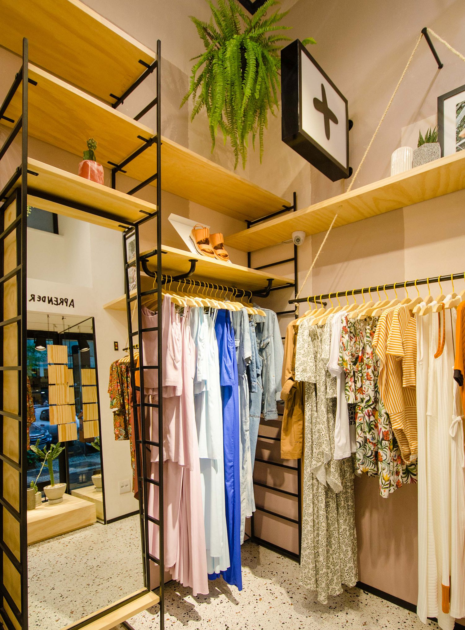 Metal-wood-and-greenery-shape-the-interior-of-the-store