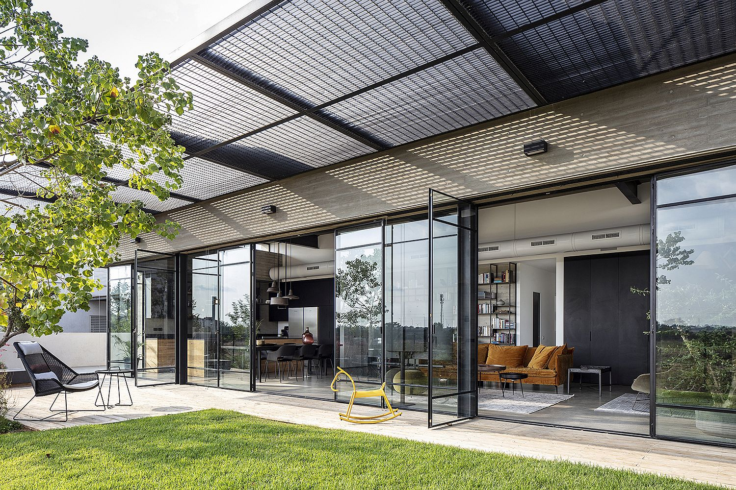 Metallic mesh pergola outside the living area provides necessary shade