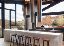 Modern-home-in-rocky-mountains-has-a-kitchen-that-is-open-on-all-sides-217x155