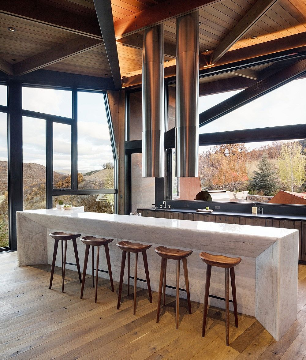 Modern home in rocky mountains has a kitchen that is open on all sides!