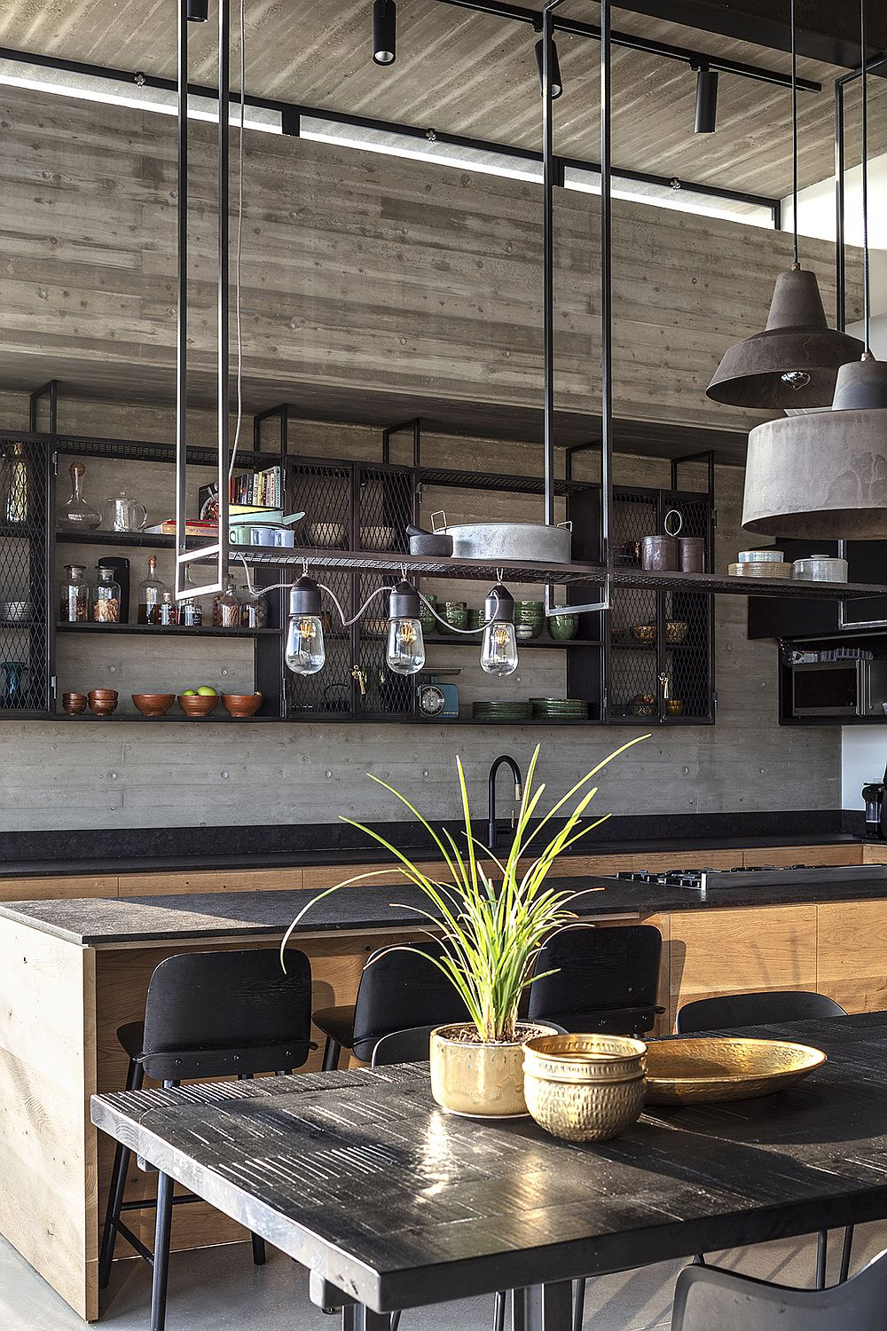 Pendant lights above the dining area with industrial style