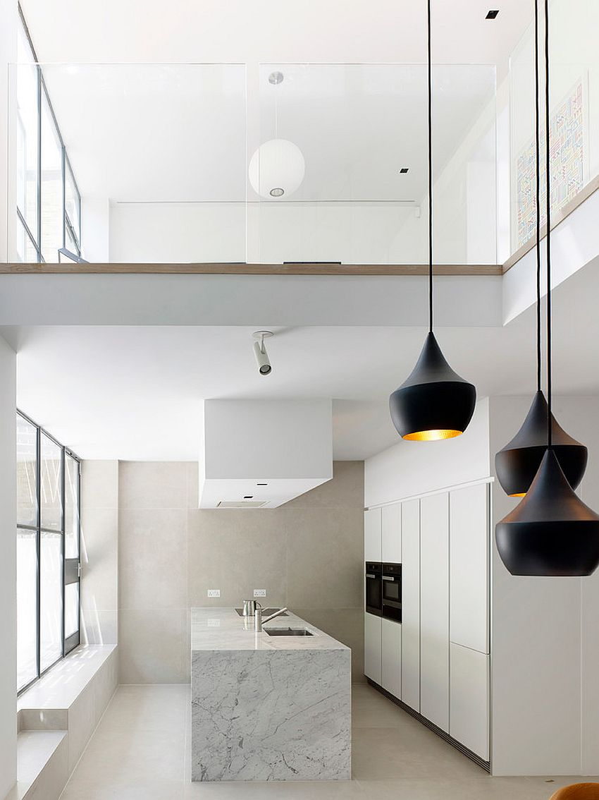 Polished apartment in white with pendants that steal the show