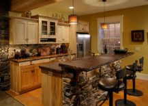 Rustic-kitchen-with-stone-walls-and-black-bar-stools-217x155
