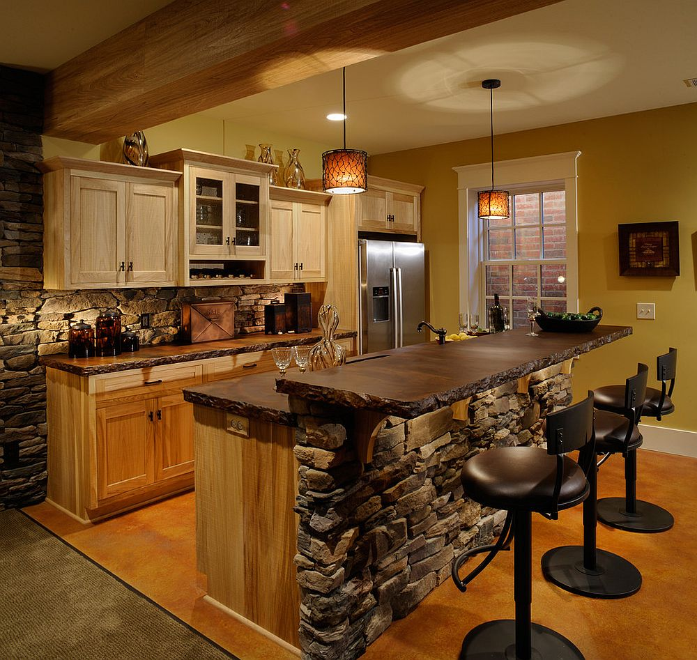 Rustic-kitchen-with-stone-walls-and-black-bar-stools