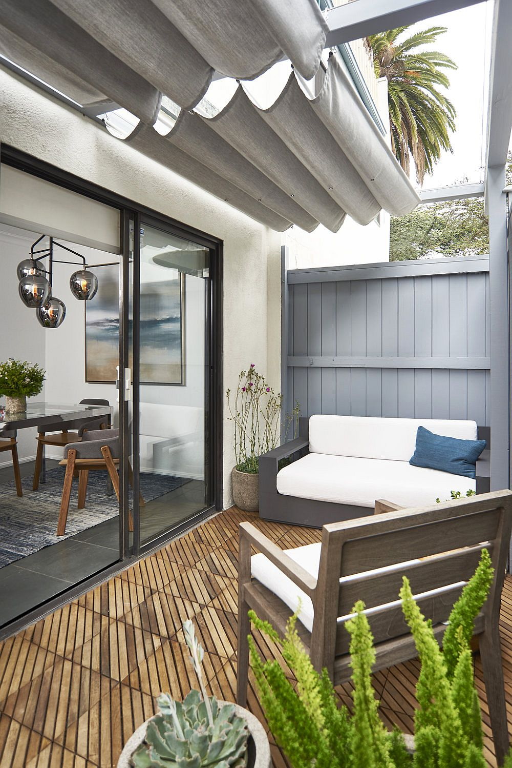 Small-private-backyard-deck-with-a-dash-of-greenery