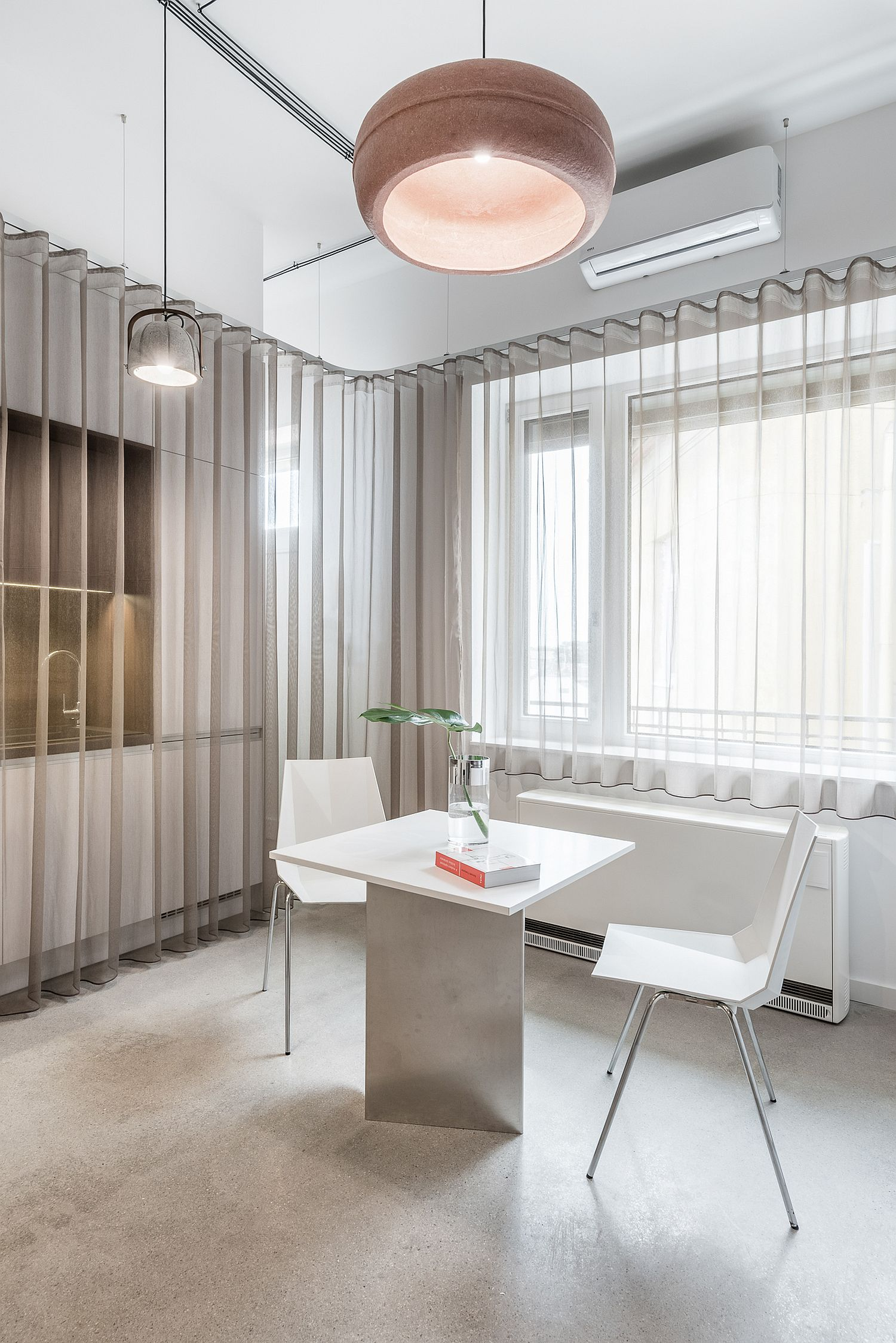 Soft gray drapes add warmth to the polished interior with ease