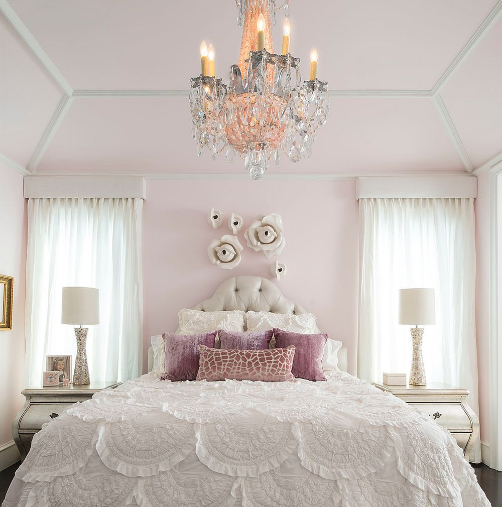 Sparkling chandelier draws your eye instantly in this white bedroom