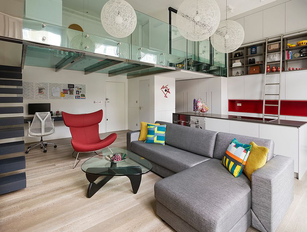 Steel and glass mezzanine level of the London apartment is eye-catching