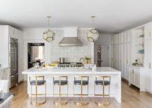 TRansitional-kitchen-with-brass-framed-bar-stools-and-a-marble-countertop-217x155