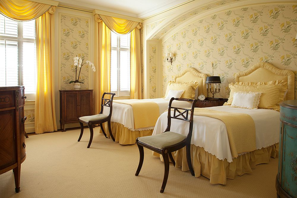 Traditional bedroom in yellow with pleasing floral pattern on walls