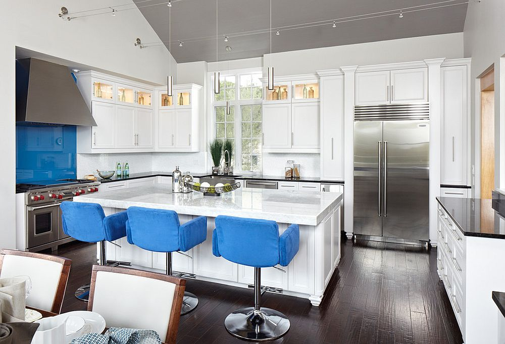 Transitional-kitchen-in-white-with-comfy-bar-stools-in-blue