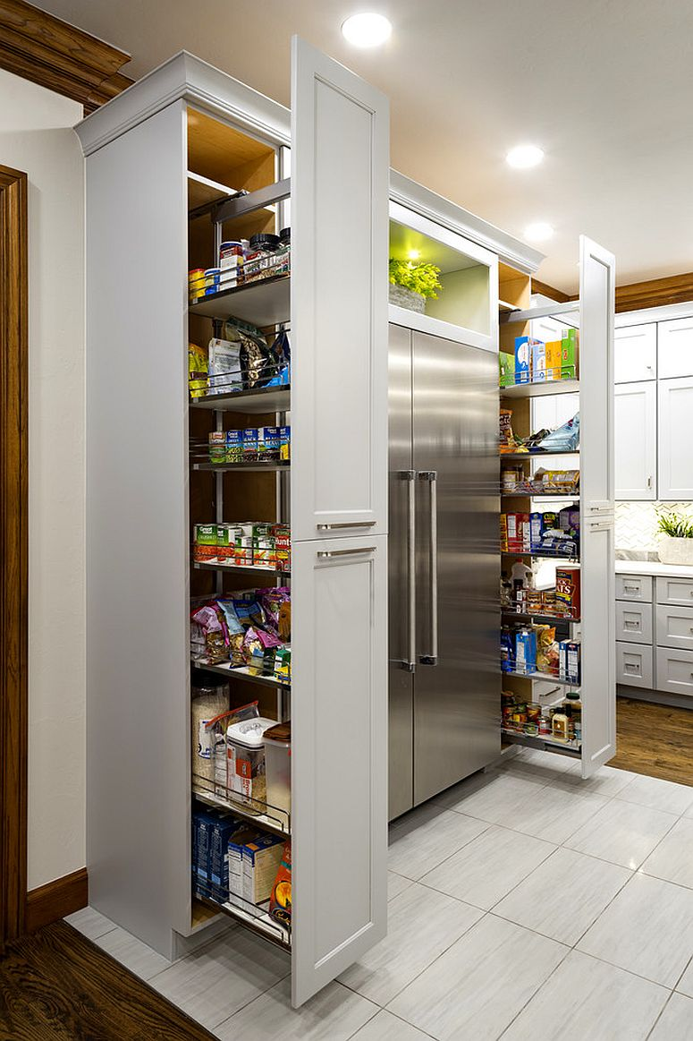 Twin floor-to-ceiling pantries on each side of the refrigerator