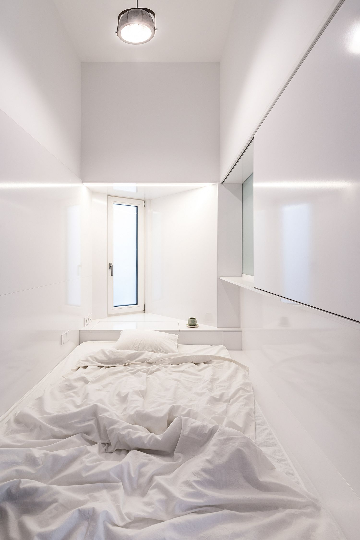Uber-tiny bedroom in white with the bare minimum