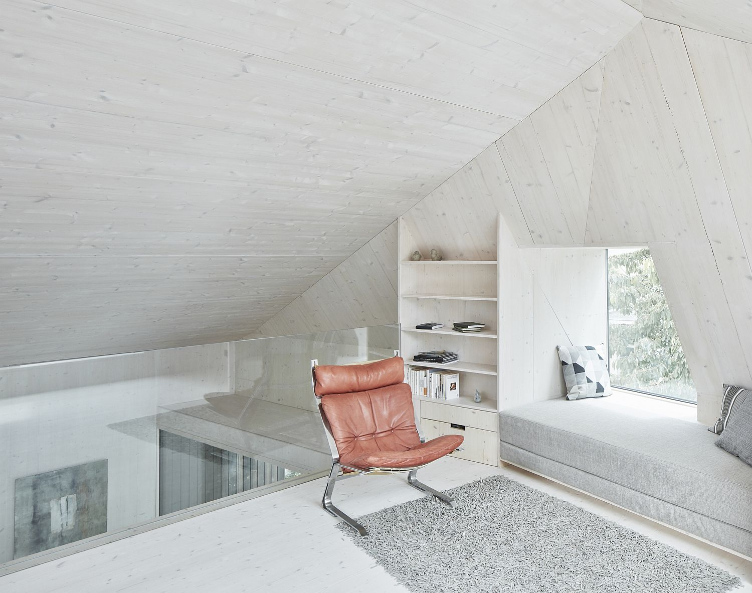 Upper level sitting area with lovely windows seats and smart cut-outs that bring the outdoors inside